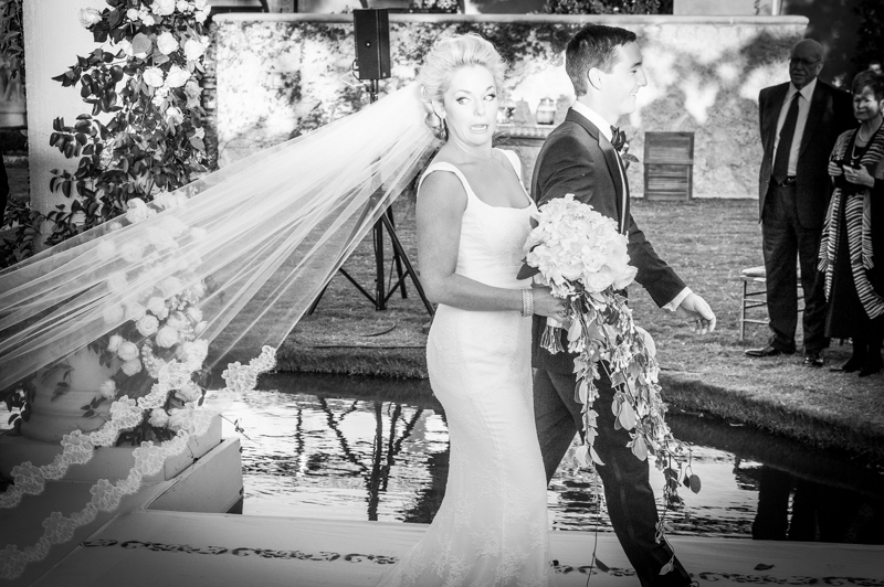 Bridal photographer in Odessa Stepping on Bride
