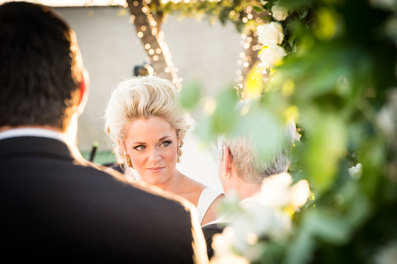 Wedding photographer in Odessa Texas Bride looking at Minister